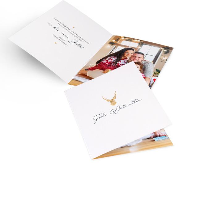 Weisse klassische Weihnachtskarten in Hoch mit goldenem Geweih und Schriftzug Frohe Weihnachten. Die Innenseiten bieten Platz fuer Text links und ein Foto rechts.