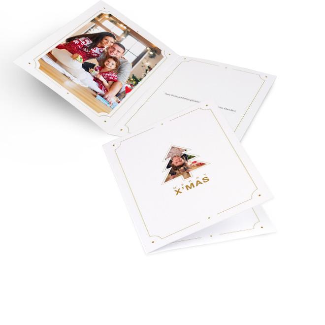 Weisse moderne Weihnachtskarten im Hochformat mit Foto-Christbaum und Schriftzug MERRY XMAS. Die Innenseiten bieten Platz fuer ein Foto links und Text rechts.